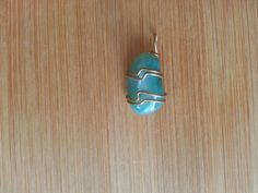 Wire wrapped Light Teal Agate Pendant by MatellaHomemadeGoods