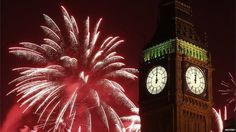 """Fireworks explode behind the Houses of Parliament and Big Ben on the River Thames during New Year""""s celebrations in London (GMT)"""