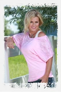 """Pin it 2 win it-Pink short sleeve blouse. Loose fit with """"Cowgirl Tuff Co."""" crystal words."""