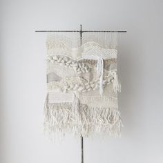 no. 102814 // the mourning hours large statement-sized handwoven textural wall hanging in shades of white and cream with layers of fringe and