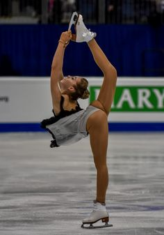 Elena RADIONOVA -Doesn't the constant wedgie bug her.  Do they not have access to costume fitters?  I think this problem could be solved by lengthening the girth of the leotard--all problems in one piece leotard based costumes come from inaccurate girth.