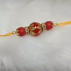 Divine Red Meenakari Bead with Matte Red Beads Thread Rakhi Craft Stick Crafts, Diy Crafts, Handmade Rakhi Designs, Rakhi Making, Rakhi Gifts, Raksha Bandhan, Matte Red, Craft Work, Handmade Shop