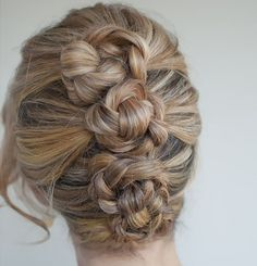 Piled braids with texture make for the perfect updo. Gently tease braids before securing atop your head for a runway-ready summer style.
