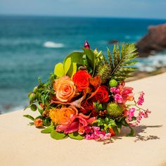 Colourful tropical flowers fill the bride's bouquet