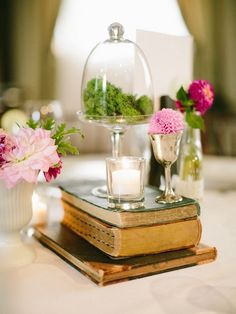 Dont be scared to include other decor elements into your centerpieces, such as vintage books, glass domes ect