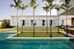 Architect Leo Romano has designed Casa do Patio, a residence located in Goiania, Brazil.  tropical moveable sun louver screens brise soleil