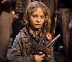 Daniel Huttlestone in Les Miserables - This kid stole every scene he was in. So cute and talented.