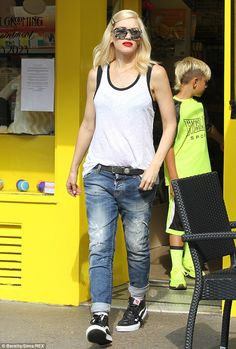 Shady lady: Gwen worked a tomboy chic look as she teamed a baggy vest top with rolled up d...