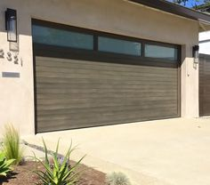 Did you remember to shut the garage door? Most smart garage door openers tell you if it's open or shut no matter where you are. A new garage door can boost your curb appeal and the value of your home. Garage Door Lights, Garage Door Colors, Garage Door Windows, Garage Door Styles, Glass Garage Door, Garage Door Design, Glass Door, Front Windows, Glass Walls