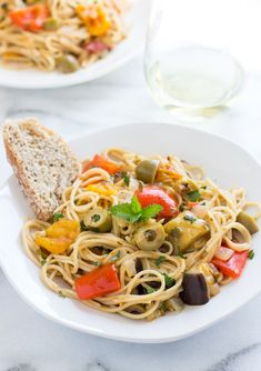 Pasta Caponata- a light Italian dish made with eggplant, tomatoes, peppers, olives and fresh herbs! #healthy #recipe