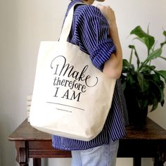 """A super-sturdy, generously sized, canvas tote bag is a thing of great beauty and use. This newest offering bears a timeless truth — """"I make, therefore I am"""" — and was hand-lettered for FSCo by the illustrious Leigh Wells. It will handle anything from a large grocery load to your current project in progress. — $16 —http://www.fringesupplyco.com/product/i-make-tote-bag"""