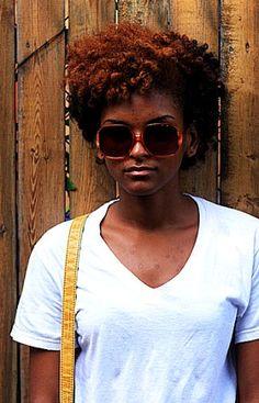 Cinnamon hair, square sunnies.