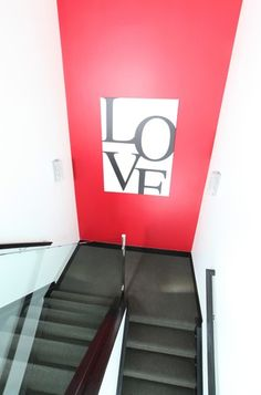 One painted wall with art in stairway