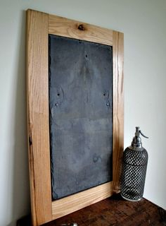 With a frame made from sustainably harvested red oak hardwood, this real slate chalkboard works well in any room. The roof slate used for this chalkboard was salvaged from a dismantled Ohio barn. Slate Shingles, Slate Roof, Tile Crafts, Wood Crafts, Nifty Crafts, Vintage Chalkboard, Tile Projects, Red Oak, Diy Painting