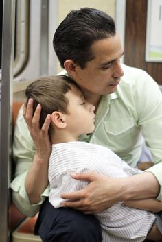 The Moment (C-Train)    This photo was taken around midnight on a Brooklyn-bound C Train. The son was sprawled out on his father's lap, sleeping. The father was cradling the boy's head in his hands. It was a pretty touching scene, and I wanted to photograph it, but I was very tired myself and I wasn't sure how much I'd be able to capture from such a close distance. Then suddenly, the father lifted his son into a sitting position, and leaned in so they were touching faces. [...]