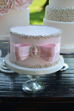 Blush and Silver Wedding Cake with Bow.