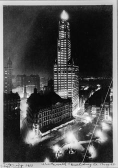 The Woolworth Building at night, looking southwest past City Hall Park and the Post Office, 1913.