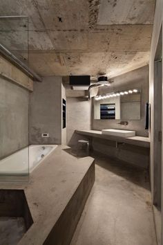 Concrete apartment renovation in Jiyugaoka by Airhouse Design Office