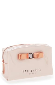 How cute is this pink Ted Baker London cosmetic case with metallic bow!
