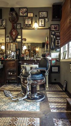 Old barber's chair in a room of curiosity. Vintage Barber Chair…