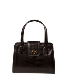 Medium bag with flap closure. Metal parts in golden. One interior pocket with zipper. Interior made of cloth. To wear it on hand.    MEASURES (H x W x depths in cm)    21 x 28 x 10    COMPOSITION    100% Bovine