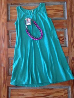 The loose fit of this teal dress is perfect for all body types. You'll be comfy and cute for any occasion!