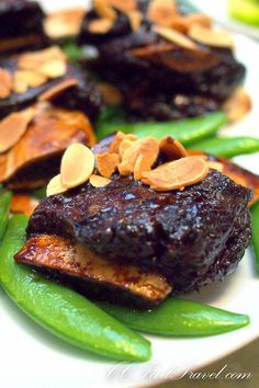 braised beef short-ribs with coffee sauce and almond flakes