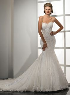 Sweetheart neckline. Trumpet and bling!
