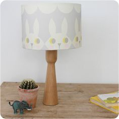 Happy Bunny lampshade made by Rebecca Södergren.   A beautiful, scandi inspired lampshade in grey and cream.  Diameter 30cm, it can be made with either a lamp or pendant fitting.   Ideal for a child's nursery, bedroom or even a lovely feature for a stylish grey inspired room.  #Kidsinteriors #children'sbedroom #nurseryideas #lampshade #scandidesigns @oxfordetsy #etsy