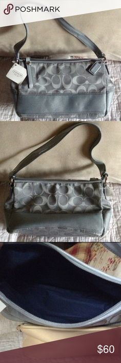 NWT Coach purse It is silver on the outside and blue inside. The stripe is shiny. There is a hangtag. It closes with a pull tag zipper. The fabric is treated to be stain and water resistant. It's 9Wx5Hx3.5D. Coach Bags Shoulder Bags