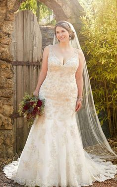 Perfect for the curvy girl who wants bling.  This Essense gown D2399 is in stock in size 24 at The Perfect Dress of Sarasota.  Call us at 941.925.5888 to schedule your appointment with our #bridalexperts