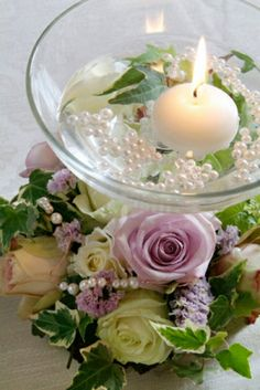 Centrepiece with White & Lavender Roses, Floating Candles, & Pearls.