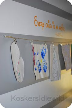 display kids artwork on a clothesline in your hallway!