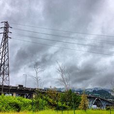 Typical #Portland. Copyright Jessica Sawyer #iphoneography #iphone4s #oregon #bridge #pnw #pacificnorthwest #cloudy #powerlines #green #pdx