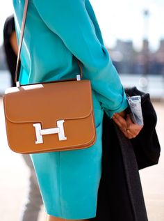Hermès love the color of this gorgeous bag against the suit!