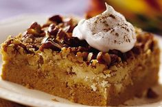 Praline Pumpkin Dessert 1 can (15 oz) pumpkin puree 1 can (12 oz) evaporated milk 3 eggs 1 C sugar 4 t pumpkin pie spice 1 box yellow or spice cake mix 1 1/2 C chopped pecans 3/4 C butter, melted Whipped cream (garnish) Heat oven to 350°F.Grease 13x9 pan.In bowl,beat pumpkin,milk,eggs,sugar, pumpkin pie spice.Pour into pan.Sprinkle dry cake mix on top.Sprinkle with pecans.Pour melted butter on top.Bake 50-60 min.Cool 30 min.Store covered in refrigerator.
