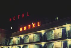 "Vintage ""Motel"" neon sign glowing at night in Portland, Oregon."