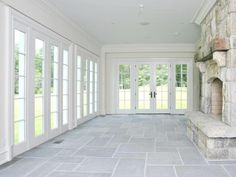 Bifold doors....Also click on site and see arched outdoor room beautiful. Three season porch idea...