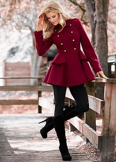 Fuschia peplum coat, black leggings, and black boots.