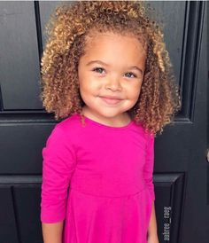 Beautiful baby girl with curly hair
