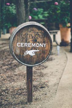 DIY barrel wedding sign: http://www.stylemepretty.com/2014/11/19/summer-malibu-wedding-at-calamigos-ranch/ | Photography: Gina & Ryan - http://ginaandryan.com/