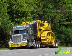 Peterbilt TriAxle; seems like a LOT of machine for just 7 axles, I say photo shop !! Looks like Komatsu D475 is being hauler here