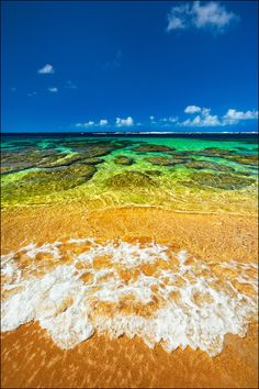 Tunnels beach is one of Kauai - Hawaii's finest beaches. The shoreline offers amazing textures of coral and sand. The colors of the ocean meeting the shallow coastline is something to behold. The view from this part of paradise similar to Peter Lik