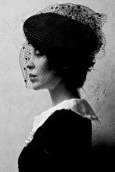 Russian style icon and fashion designer, Ulyana Sergeenko, in a modern interpretation of the 1950s...