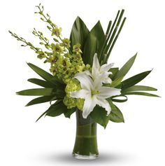 A51V - Splendour. The graceful beauty of white lilies and opulent orchids is highlighted with an artistic, emerald-green backdrop of tropical leaves presented in a leaf lined vase.
