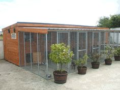 For all types of Dog Runs and Kennels made to order ,We can make to your specifations and designs .We only use top quality timber and steel in our buildings .See our display in our show yard . Dog Kennel And Run, Diy Dog Kennel, Kennel Ideas, Husky Kennel, Cheap Outdoor Dog Kennels, Dog Boarding Kennels, Dog Kennel Designs, Outside Dogs, Pet Hotel