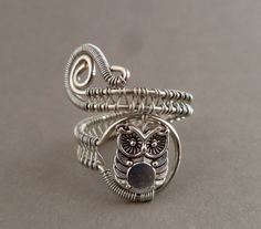 love the idea of placing a charm inside.  Owl Wire Wrapped Ring // wire wrapped by PillarOfSaltStudio, $20.00.