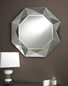 This circular mirror has a fascinating geometric clear glass border made up of triangular pieces giving an angular star shaped 3D multifacet effect. It's bold unique style would be an dramaticaly cool feature to any room. Diameter: 80cm & 90cm http://www.totalmirrors.com/multi-facet-mirrors/192-round-pyramid-mirror-80cm-diameter-5055157621753.html