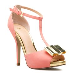 This prim T-strap pump by Madison gets updated with a glinting bow applique and additional metallic accents. Contrast its delightful sorbet hue with a black-on-