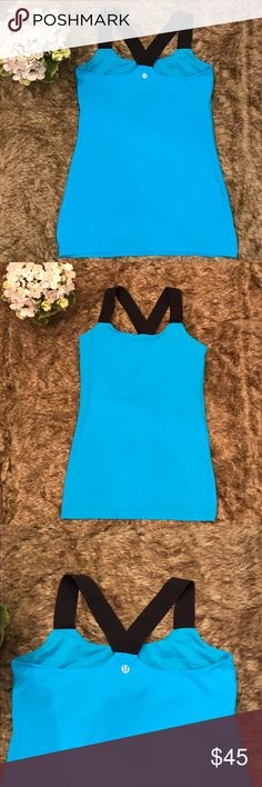 Lululemon tank Top Cute Lulu In a beautiful turquoise color with black elastic straps. In excellent condition. No Trades.  Accepting Reasonable Offers. 😊 lululemon athletica Tops Tank Tops